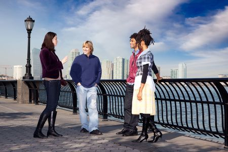 A group of friends on a city walk way by the water Stock Photo - 5971857