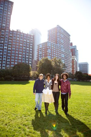 A group of college students in a park - shot against the sun with solar flare Stock Photo - 5981872