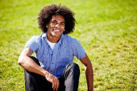 big smile: A young african american man isolated on grass with big smile Stock Photo