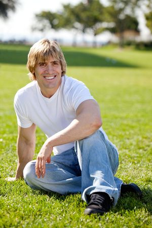 A fit adult male resting on grass Stock Photo - 5981903