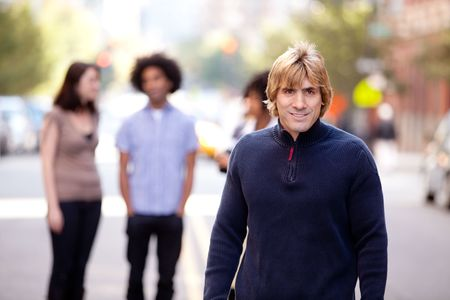 A group of people in a city setting - a caucasian male in the foreground Stock Photo - 5981880