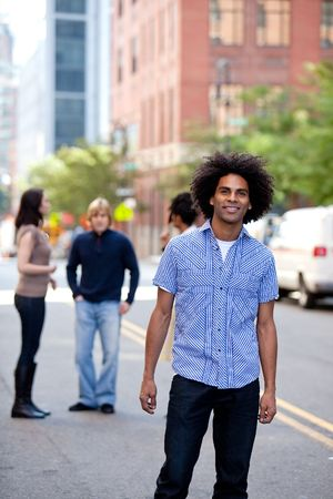 A young adult in a city setting with friends Stock Photo - 5981875