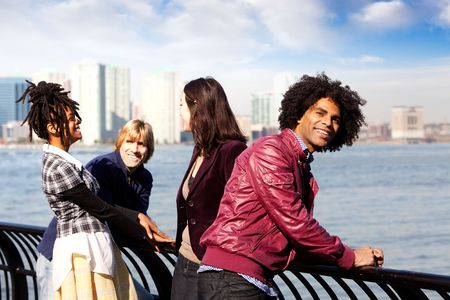 A group of friends in the city - overlooking a harbor and skyline photo