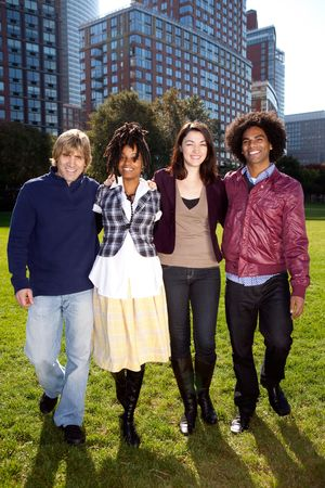 college dorm: A group of college students in a park - shot against the sun with solar flare