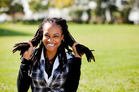 A young African American woman having fun - isolated on green Stock Photo - 6053466