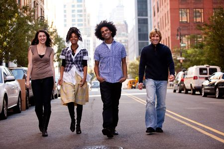 A group of friends on a street in a large city photo