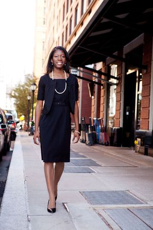An African American business woman in an urban setting. Stock Photo - 6053444