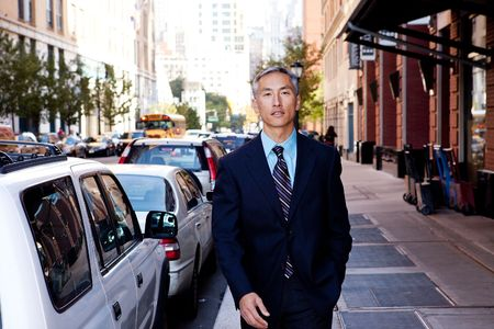 A business man in a city setting on a sidewalk photo