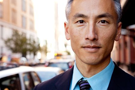 asian business man: A successful business man in a street setting