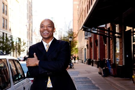 optimistic: A happy business man, downtown in a city