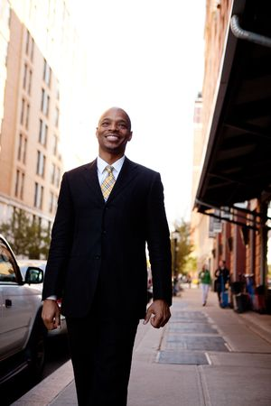 A street portait of a busienss man walking down the sidewalk Stock Photo - 6053479