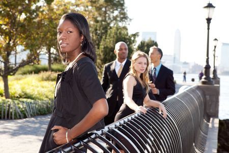 A business team outside - sharp focus on front woman photo