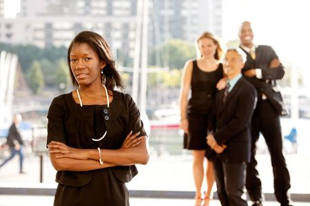 Group of four business people with one woman as focus. Horizontally framed shot. photo