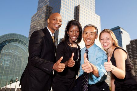 Four business people giving thumbs up. Horizontally framed shot. photo