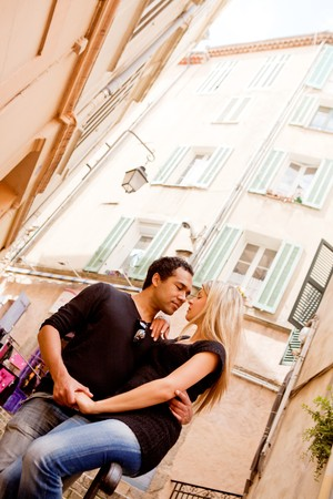 A happy european couple in a small quaint street photo