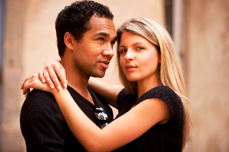 An attractive french couple in an outdoor urban setting photo