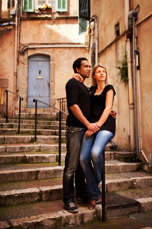 An attractive couple in a quaint european street photo