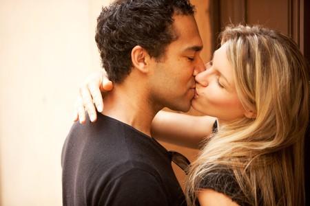 A couple kissing outdoors in an European urban setting photo