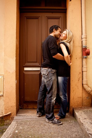 A couple having fun and flirting in an European French Street Stock Photo - 7652592