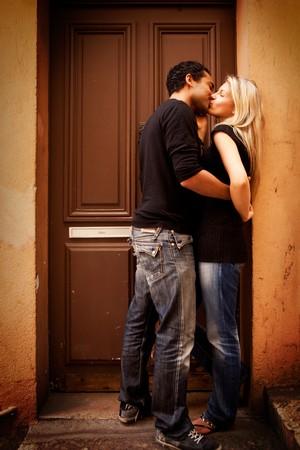A couple kissing in an urban European setting photo