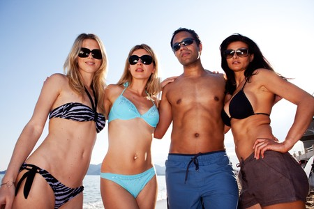 A group of friends on the beach with a group hug Stock Photo - 7630440