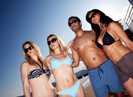 A group of models on the beach against a blue sky Stock Photo - 7652994