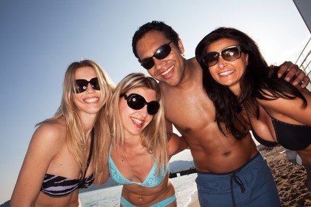 A group of friends having fun on the beach Stock Photo - 7653021