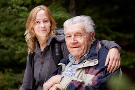 A portrait of a granddaughter with her grandfather in the forest Stock Photo - 7630528