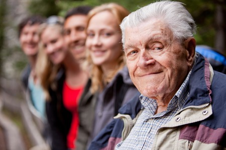 citizen: An elderly man in front of a group of young people