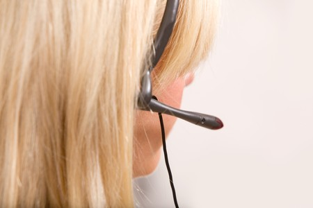 A detail of a receptionist with a headset Stock Photo - 7629912