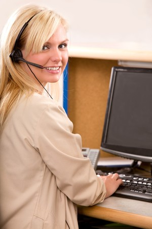 A happy bonde recpetionist with a phone headset Stock Photo - 7630517