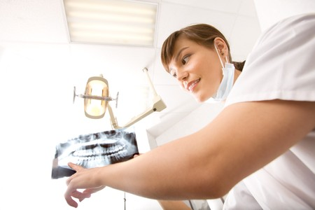 A dentist showing an x-ray of adult teeth Stock Photo - 7629894
