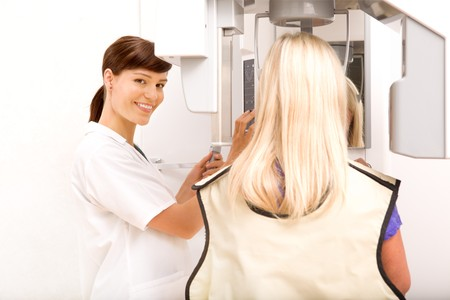A woman taking a panoramic digital x-ray of a patients teeth Stock Photo - 7629900