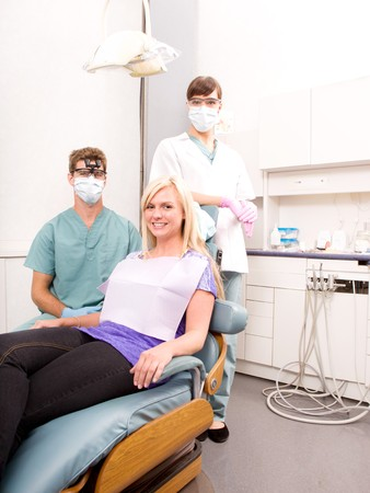 dental clinic: A dentist, assistant and patient in a dental clinic Stock Photo