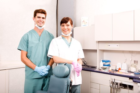 A portrait of a dentist and an assistant photo