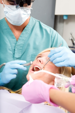 A dentist working on a tooth at a dental clinic Stock Photo - 7652972