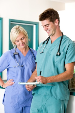 A vet and assistant looking and writing in a chart Stock Photo - 7683013