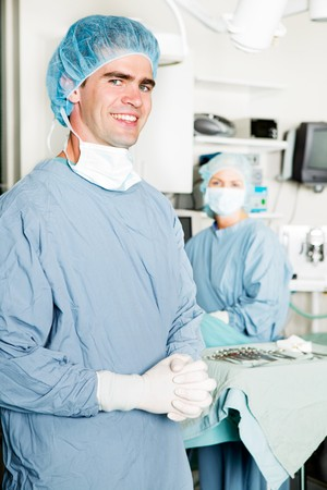 medic: A portrait of a male surgeon with an opration theater in the background Stock Photo