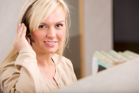 A happy receptionist with a phone headset photo