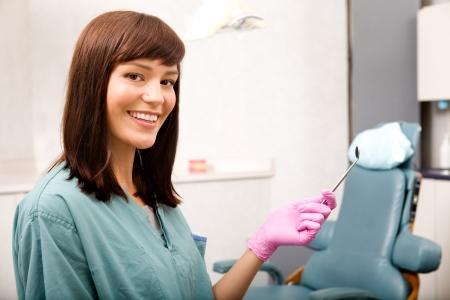 dental healthcare: Un retrato de mujer de dentista o higienista dental