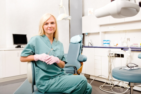 dental nurse: A portrait of a female dentist in a clinic  Stock Photo