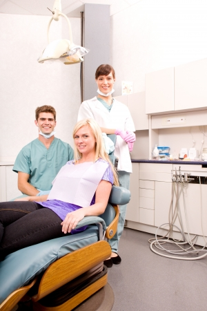 A dental clinic with dentist, assistant and patient photo