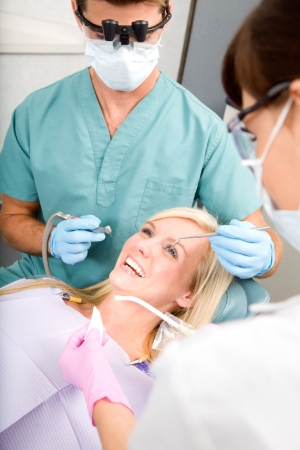 surgery tools: A woman at the dentist about to have some drilling done Stock Photo