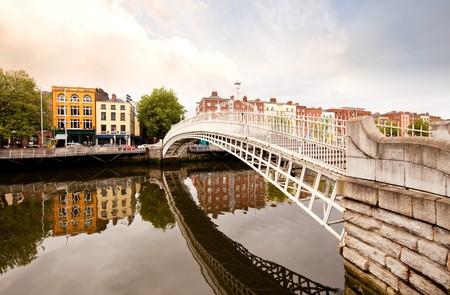 penny: A famous toursit attraction in Dublin, Ireland, Hapenny Bridge. Stock Photo