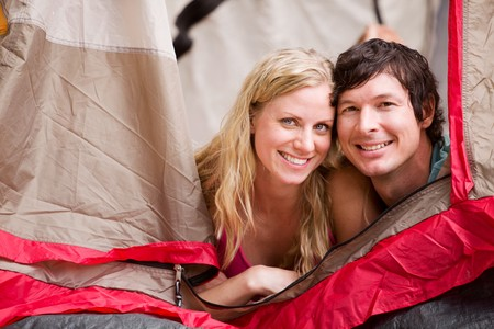 A portrait of a couple smiling in a tent Stock Photo - 8043888