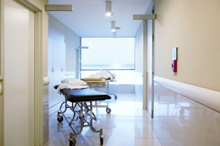 hallway: An intrior of a hospital hallway with a couple stretchers