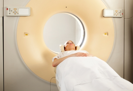 A woman having a CT Scan taken photo