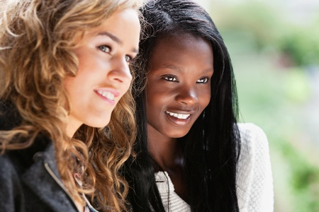 Close-up of two happy young females looking away Stock Photo - 9283417
