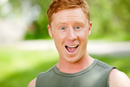 Excited man with mouth open against blur background Stock Photo - 9282905
