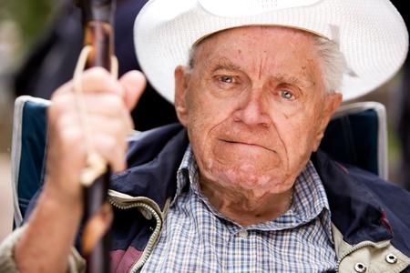 grumpy old man: A portrait of a grumpy old man sitting in a chair